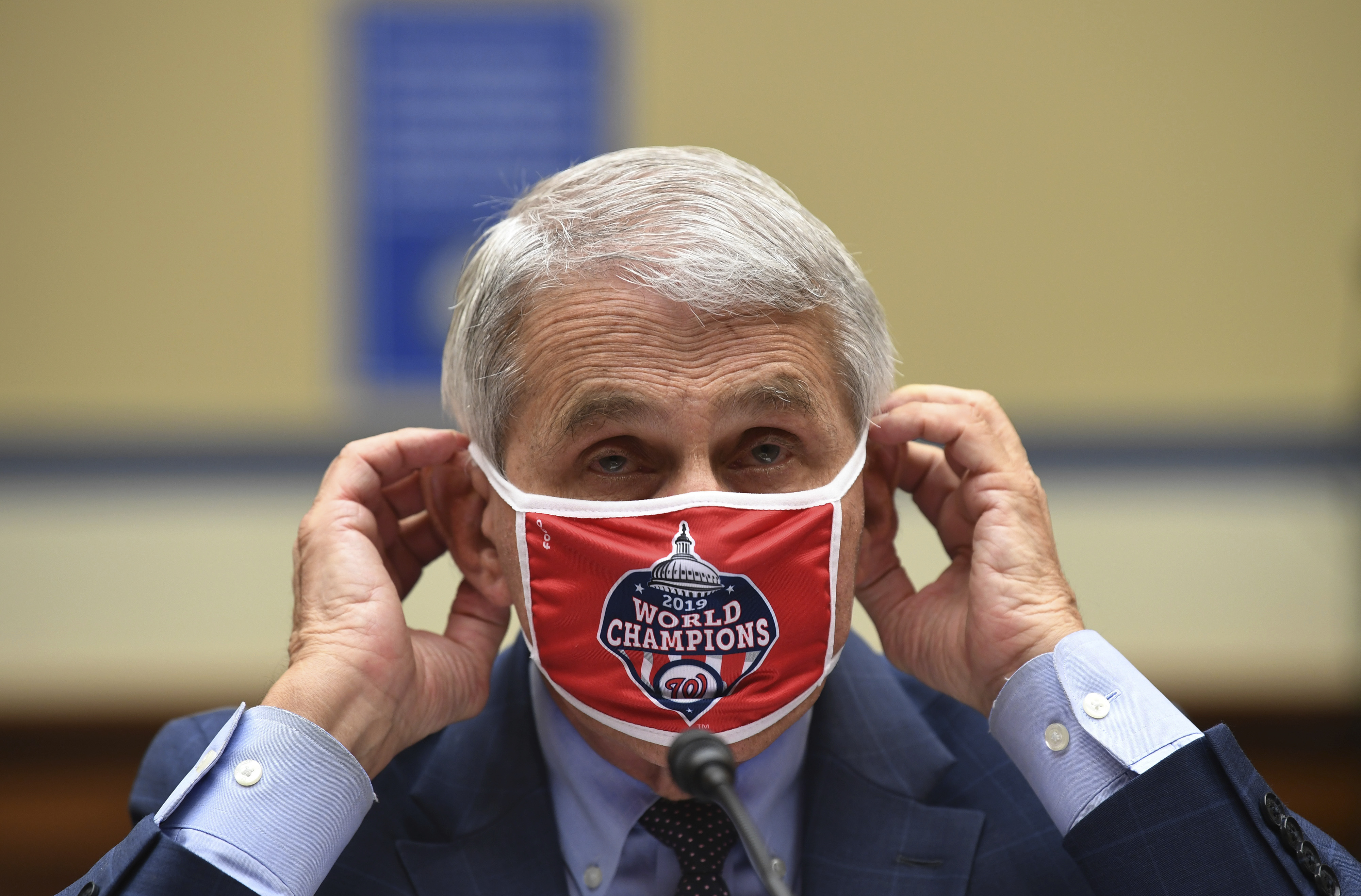 Dr. Anthony Fauci, director of the National Institute for Allergy and Infectious Diseases, adjusts his face mask during a House Subcommittee on the Coronavirus crisis hearing, Friday, July 31, 2020 on nCapitol Hill in Washington. Photo: AP