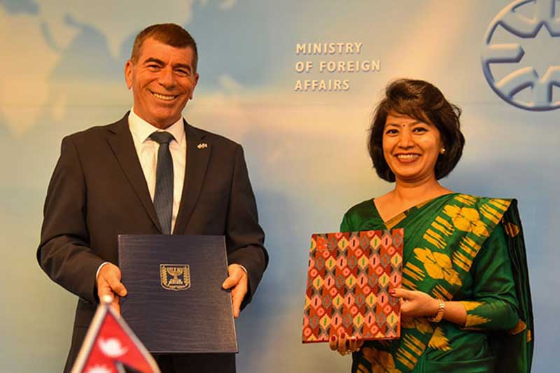 Ambassador of Nepal to Israel Anjan Shakya (right) and Israeli Foreign Minister Gabi Ashkenazi sign the agreement on behalf of their respective governments at a function held at the Israeli Ministry of Foreign Affairs in Jerusalem, Israel on Thursday, August 20, 2020.