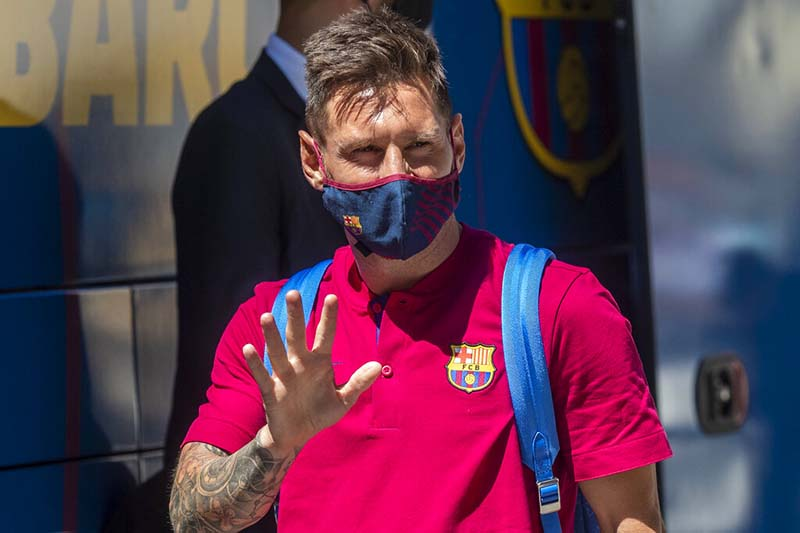FILE - Barcelona's Lionel Messi waves as he arrives at the team hotel in Lisbon, Portuga,  on August 13, 2020. Lionel Messi has told Barcelona he wants to leave the club after nearly two decades with the Spanish giants. Photo: AP