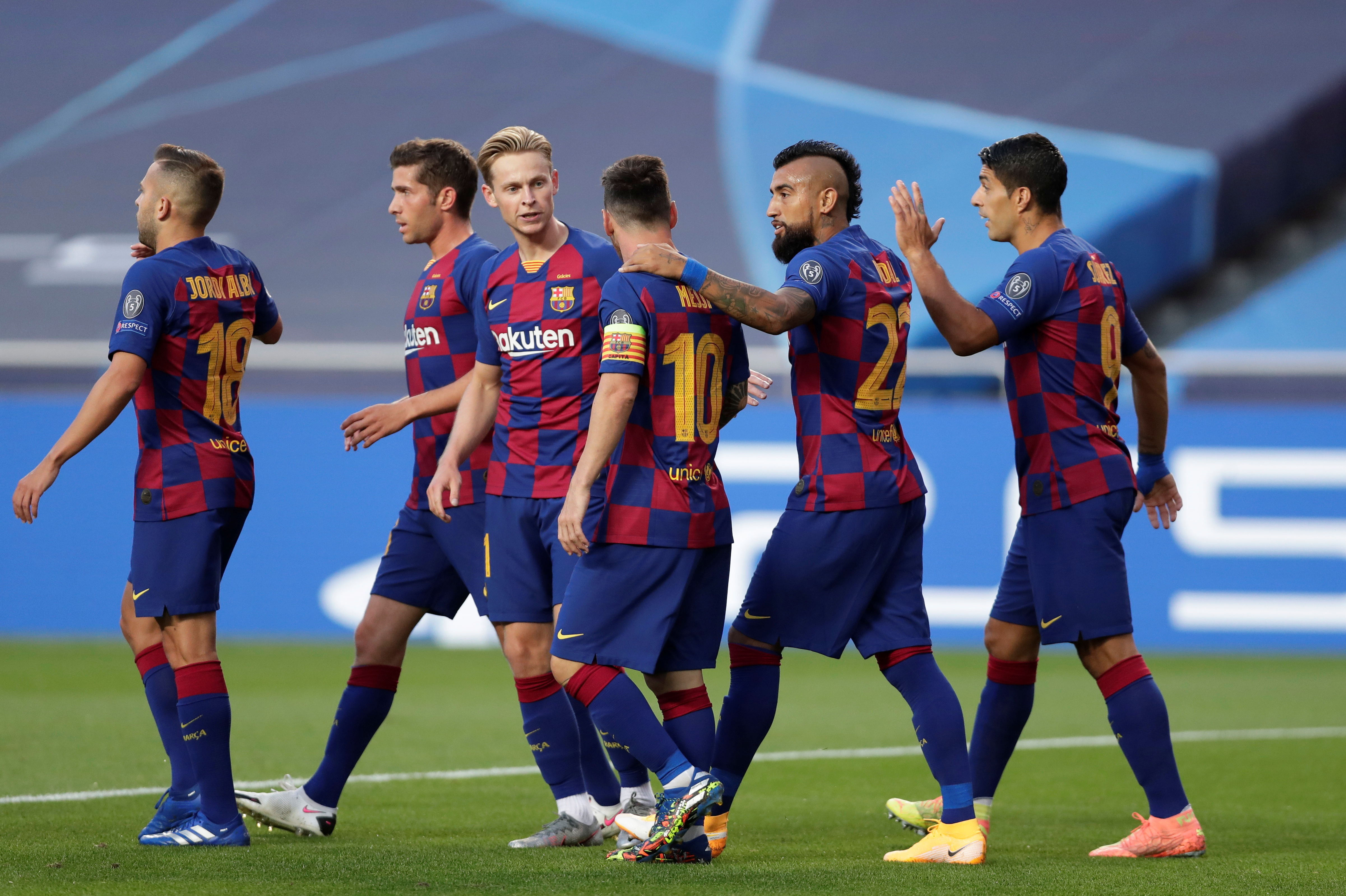 Barcelona players celebrate with teammates after Bayern Munich's David Alaba scored an own goal and their first goal, as play resumes behind closed doors following the outbreak of the coronavirus disease (COVID-19). Photo: Reuters