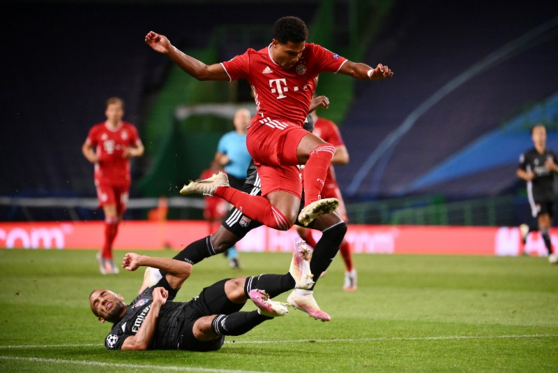 Olympique Lyonnais' Marcal in action with Bayern Munich's Serge Gnabry during their Champions League Semi Final match at Jose Alvalade Stadium, in Lisbon, Portugal, on August 19, 2020, as play resumes behind closed doors following the outbreak of the coronavirus disease (COVID-19). Photo: Franck Fife/Pool via Reuters