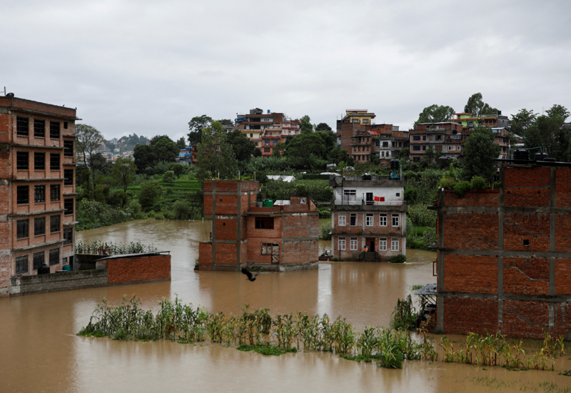 Houses are seen submerged in the waters as a river overflows due to incessant rainfall in Bhaktapur, Nepal July 20, 2020. Photo: Reuters/File
