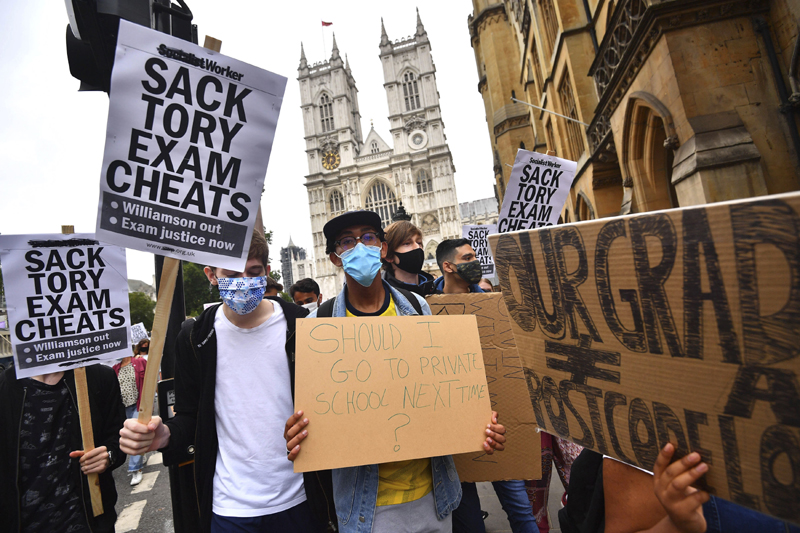 People take part in a protest in Westminster in London over the government's handling of A-level results, Friday, Aug. 14, 2020. Photo: Victoria Jones/PA via AP