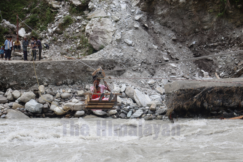 Local crossing the Budhiganga River with the help of a tuin in Jadanga, Bajura, on Sunday, August 23, 2020. Photo: Prakash Singh/THT
