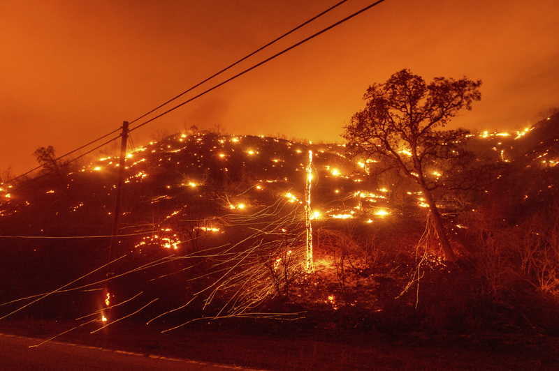Seen in a long exposure photograph, embers burn along a hillside as the LNU Lightning Complex fires tear through unincorporated Napa County, Calif., on Tuesday, Aug. 18, 2020. Photo: AP