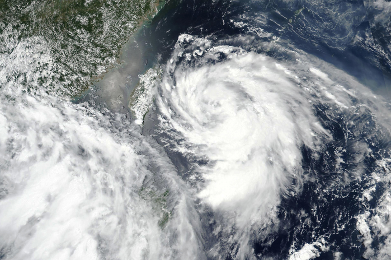 This Sunday, Aug. 2, 2020, satellite image released by NASA shows Typhoon Hagupit approaching Taiwan, center left. Vulnerable coastal areas of eastern China are being evacuated in anticipation of Typhoon Hagupit making landfall late Monday, Aug. 3, 2020, bringing gales and heavy rainfall at a time when much of the country is still recovering from unusually summer heavy flooding.  Photo: NASA Worldview, Earth Observing System Data and Information System (EOSDIS) via AP