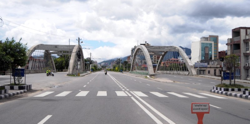 A view of the deserted road during a week-long prohibitory order imposed in Kathmandu valley to curb the spread of coronavirus infection, near the arch bridges in Bijuli Bazaar, Kathmandu, as pictured on Tuesday, August 25, 2020. Photo: Balkrishna Thapa/THT