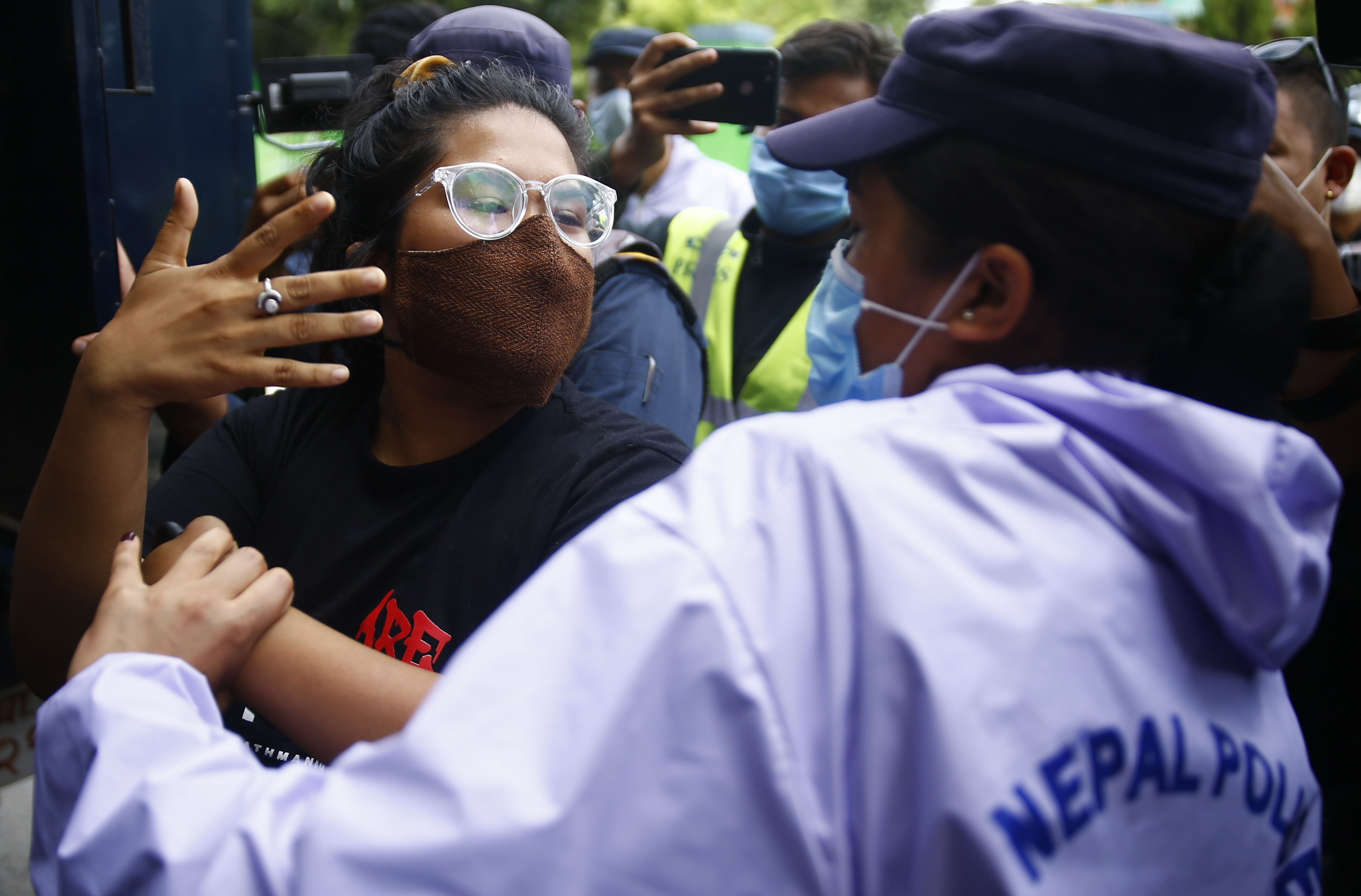 Police arrest a youth during a protest demanding that the government honour the recently struck 12-point deal for better COVID-19 response, near the Prime Minister's official residence, in Baluwatar, Kathmandu, on Saturday, August 1, 2020. Photo: Skanda Gautam/THT