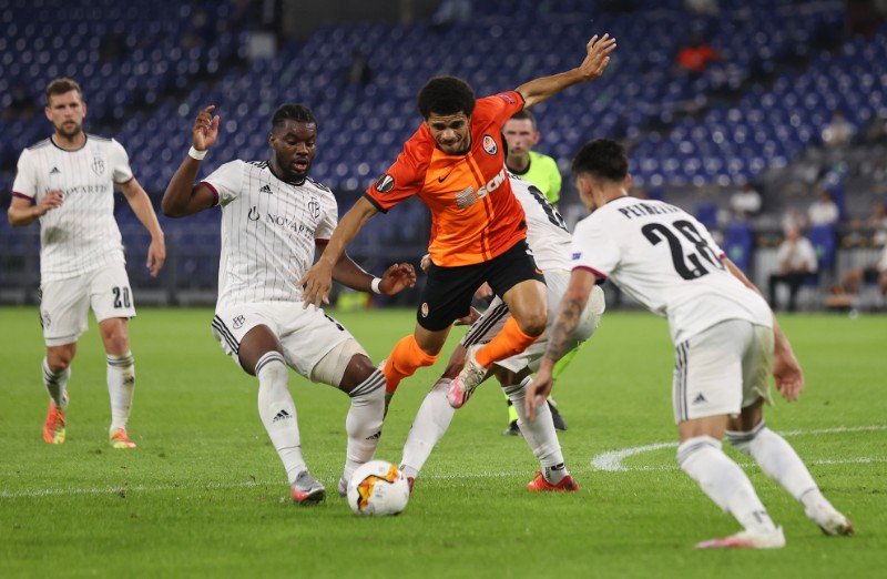 Shakhtar Donetsk's Taison in action with Basel's Raoul Petretta during their Europa League Quarter Final match at Veltins, Arena, in Gelsenkirchen, Germany, on August 11, 2020, as play resumes behind closed doors following the outbreak of the coronavirus disease (COVID-19). Photo:  Pool via Reuters