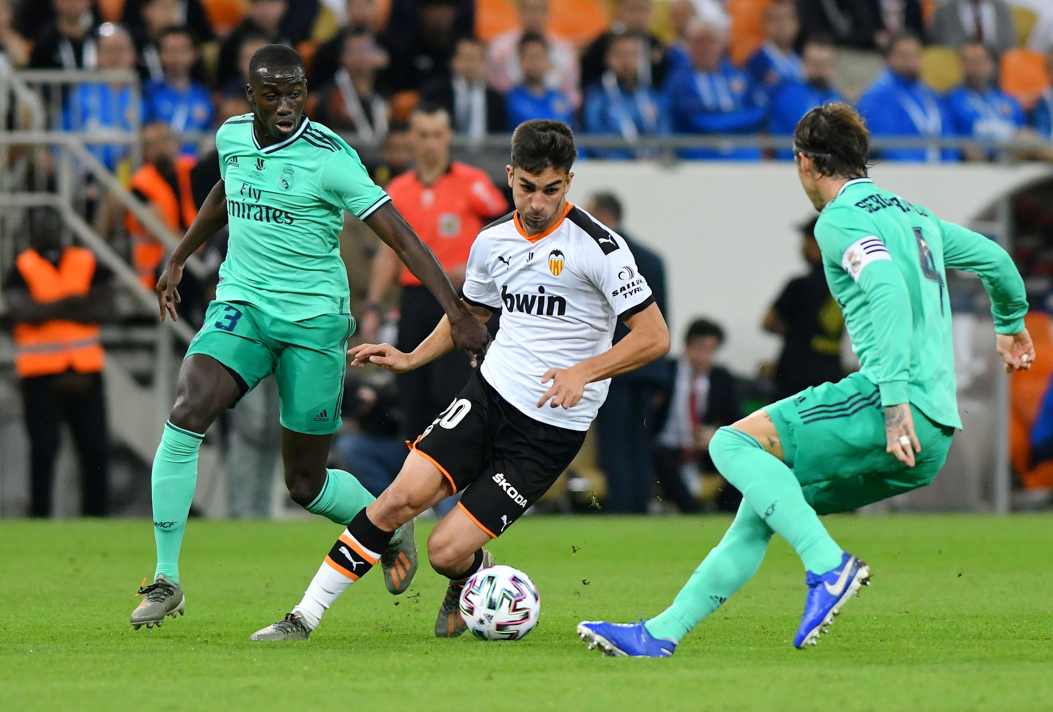 Valencia's Ferran Torres in action with Real Madrid's Sergio Ramos and Ferland Mendy. Photo: Reuters