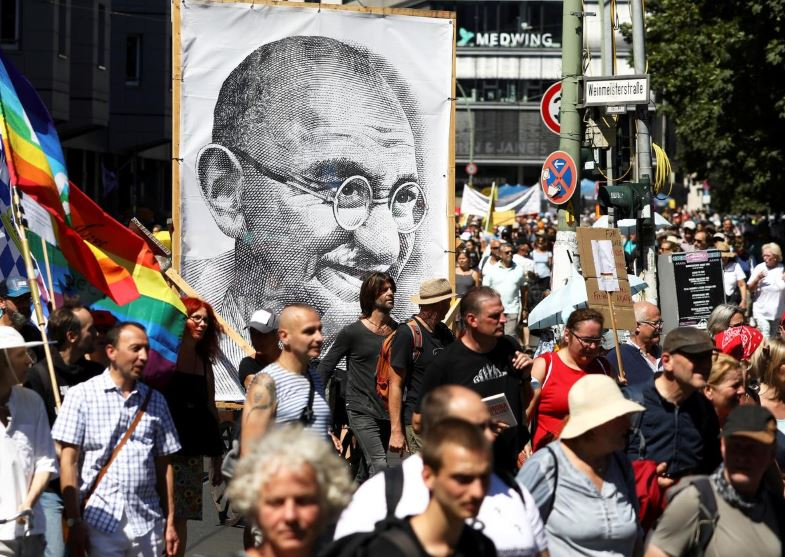 FILE PHOTO: A portrait of Mahatma Gandhi is pictured as demonstrators march during a protest against the government's restrictions amid the coronavirus disease (COVID-19) outbreak, in Berlin, Germany, August 1, 2020. Photo: AP