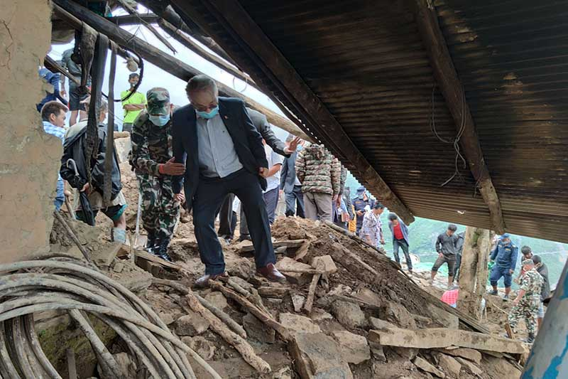 Minister for Home Affairs Ram Bahadur Thapa on onsite inspection at the landslide-hit settlement of Lidi in Jugal Rural Municipality-2, Sindhupalchok district, on Friday, August 14, 2020. Photo: RSS