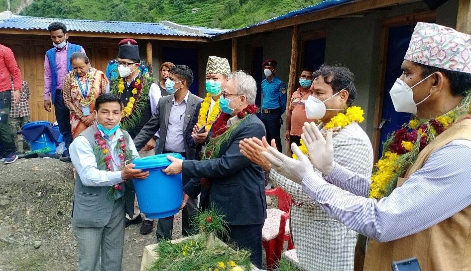 Home Minister Ram Bahadur Thapa handing over relief materials to Gaumul Rural Municipality Chairperson Hari Bahadur Rokaya, in Bajura, on Tuesday. Photo: THT