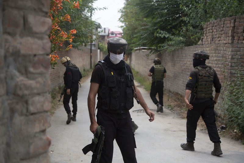 Members of special Operations Group (SOG) of Jammu and Kashmir police examine at the site of an attack on policemen on the outskirts of Srinagar, Indian controlled Kashmir, Friday, Aug. 14, 2020. Photo:AP