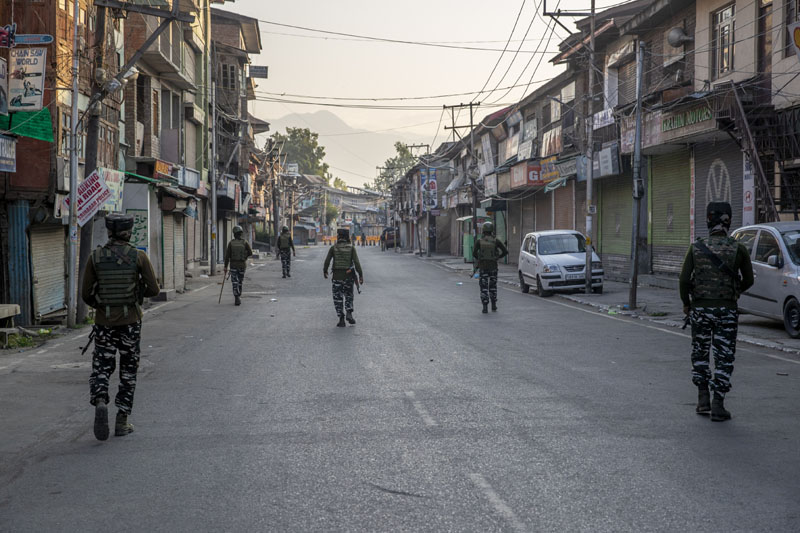 Indian paramilitary soldiers patrol a deserted street on the first anniversary of Indiau0092s decision to revoke the disputed regionu0092s semi-autonomy, in Srinagar, Indian controlled Kashmir, Wednesday, Aug. 5, 2020. Photo: AP