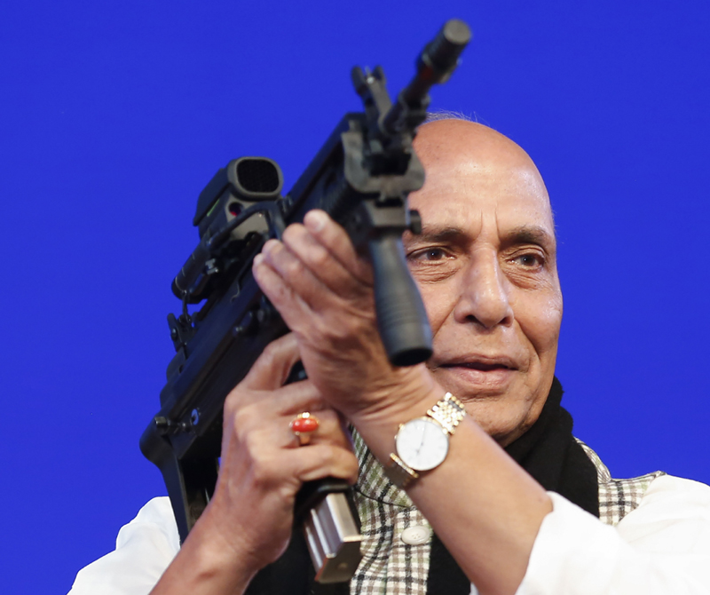In this Feb. 7, 2020 file photo,  Indian Defense Minister Rajnath Singh holds a model of a light machine gun during DefExpo20 in Lucknow, India. Photo: AP /File