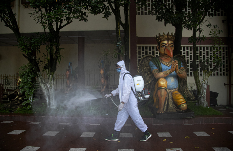 An Indian health worker disinfects an area in Gauhati, India, Thursday, Aug. 13, 2020. Photo: AP