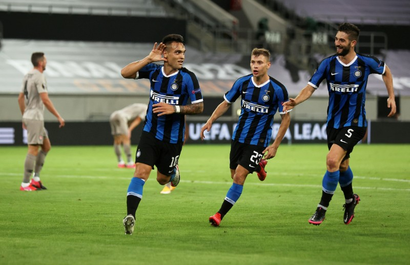Inter Milan's Lautaro Martinez celebrates scoring their third goal during the  Europa League Semi Final match between Inter Milan and Shakhtar Donetsk, at Merkur Spiel-Arena, in Dusseldorf, Germany, on August 17, 2020, as play resumes behind closed doors following the outbreak of the coronavirus disease (COVID-19). Photo: Lars Baron/Pool via Reuters