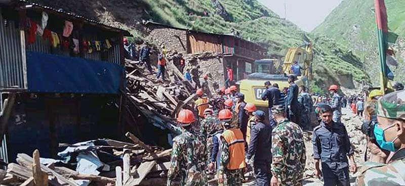 Security personnel rescue people from the houses buried in a landslide at Nagma Bazaar, Tilagufa Municipality-1 in Kalikot district, on Sunday, August 30, 2020. At least four members of a family were killed after landslides swept away four houses. Photo: RSS.