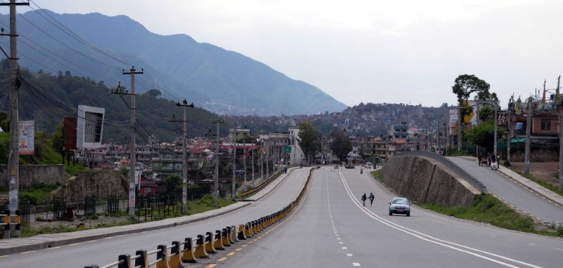 An empty road is pictured after the government imposed a prohibitory order effective from today to curb the increasing spread of coronavirus infection, near Ekantakuna, Lalitpur, on Thursday, August 20, 2020. Photo: Balkrishna Thapa/THT