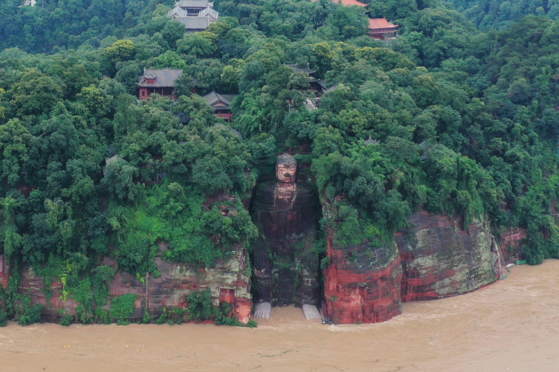 Floodwater reaches the Leshan Giant Buddha's feet following heavy rainfall, in Leshan, Sichuan province, China August 18, 2020. Picture taken August 18, 2020. Photo: China Daily via Reuters