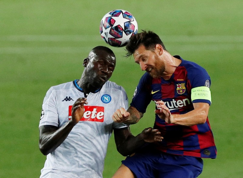 Barcelona's Lionel Messi in action with Napoli's Kalidou Koulibaly during their Champions League -Round of 16 Second Leg, at Camp Nou, in Barcelona, Spain, on  August 8, 2020, as play resumes behind closed doors following the outbreak of the coronavirus disease (COVID-19). Photo: Reuters