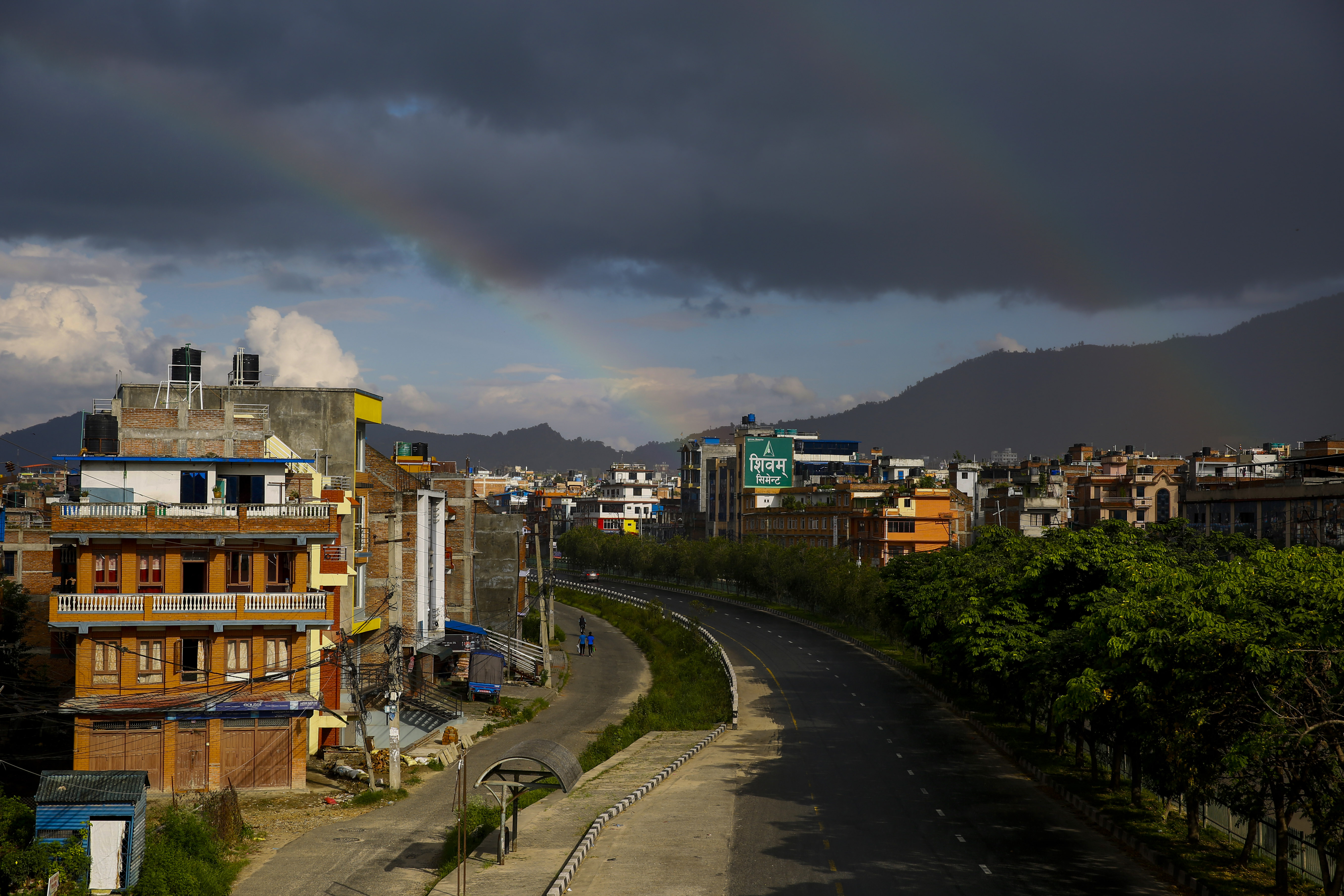 The deserted road is pictured during the second phase of shutdown following steady spike in coronavirus cases, as a rainbow appears over the sky in Bhaktapur, on Saturday. Photo: Skanda Gautam/THT