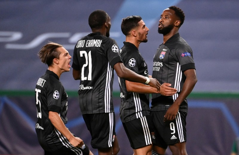Olympique Lyonnais' Moussa Dembele celebrates scoring their third goal with teammates during the Champions League Quarter Final match between Manchester City and Olympique Lyonnais, at Jose Alvalade Stadium, in Lisbon, Portugal, on August 15, 2020, as play resumes behind closed doors following the outbreak of the coronavirus disease (COVID-19). Photo: Franck Fife/Pool via Reuters