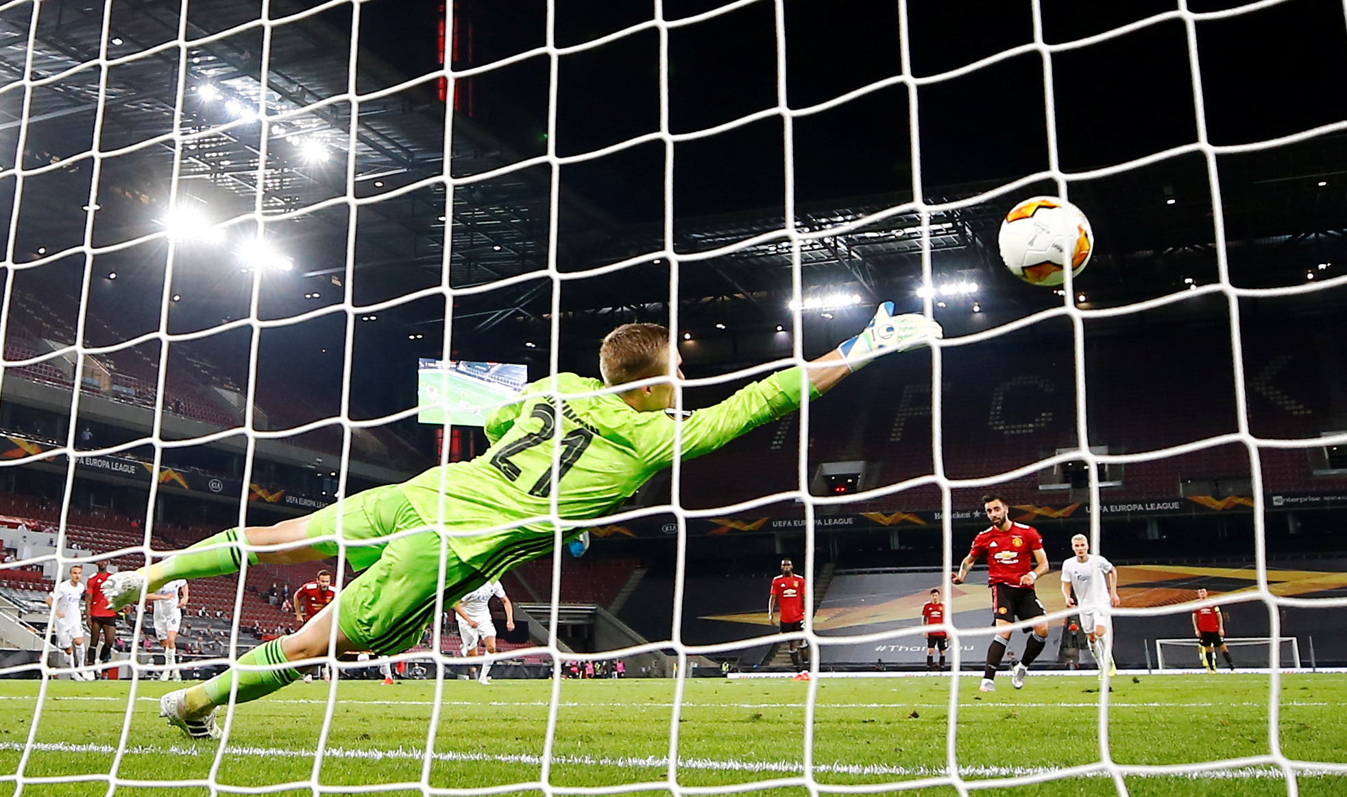 Manchester United's Bruno Fernandes scores their first goal from the penalty spot during the Europa League Quarter Final match between Manchester United and FC Copenhagen, at RheinEnergieStadion, in Cologne, Germany, on  August 10, 2020, as play resumes behind closed doors following the outbreak of the coronavirus disease (COVID-19). Photo: Pool via Reuters