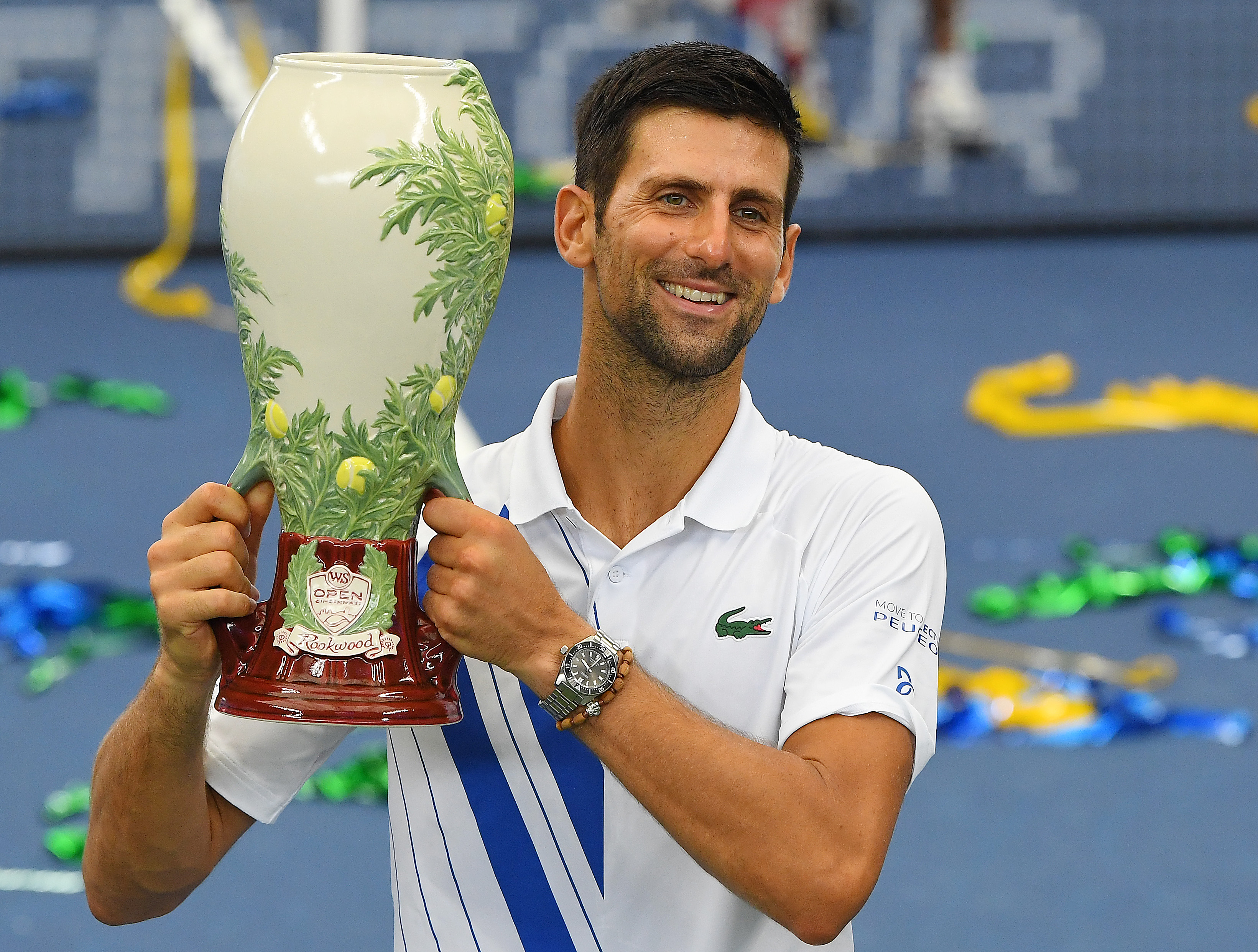 Mens champion Novak Djokovic (SRB) poses with the trophy following his win over Milos Raonic (CAN) in the Western & Southern Open at the USTA Billie Jean King National Tennis Center. Mandatory Credit: Robert Deutsch-USA TODAY Sports