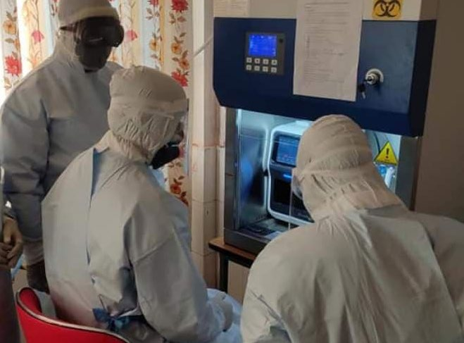 Technicians carrying out polymerase chain reaction tests in Dadeldhura Hospital, on Monday. Photo: THT