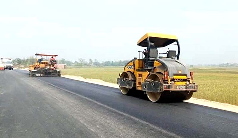 File - A paver being used to lay asphalt and a road roller to compact asphalt on the road being constructed under Postal Highway Project, in the road section from Pratimachok in Birgunj to Sedhawa, during lockdown period. Photo: Ram Sarraf/THT