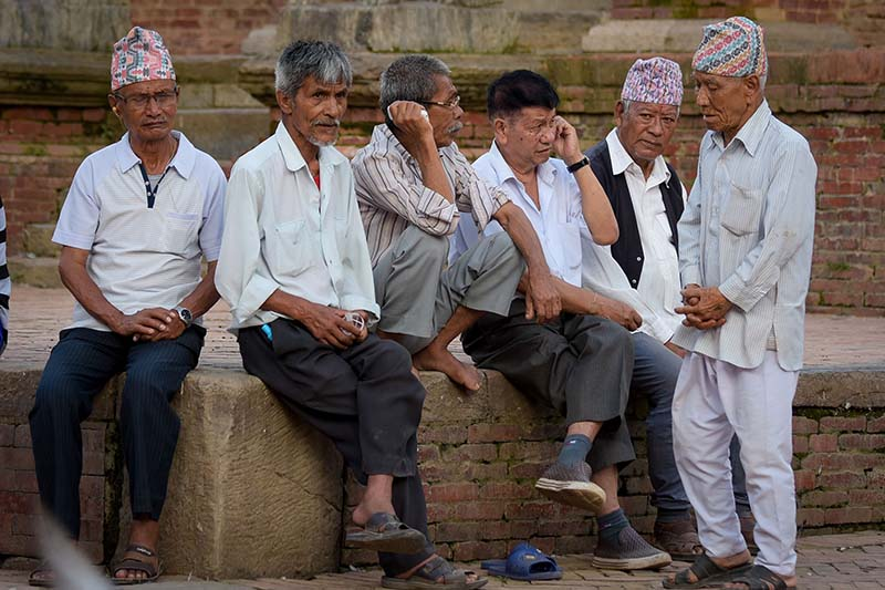 Elderly people whiling away time at a public place without wearing face masks or maintaining social distance, amidst the coronavirus pandemic, in Lalitpur, on Wednesday, August 12, 2020. Photo: THT