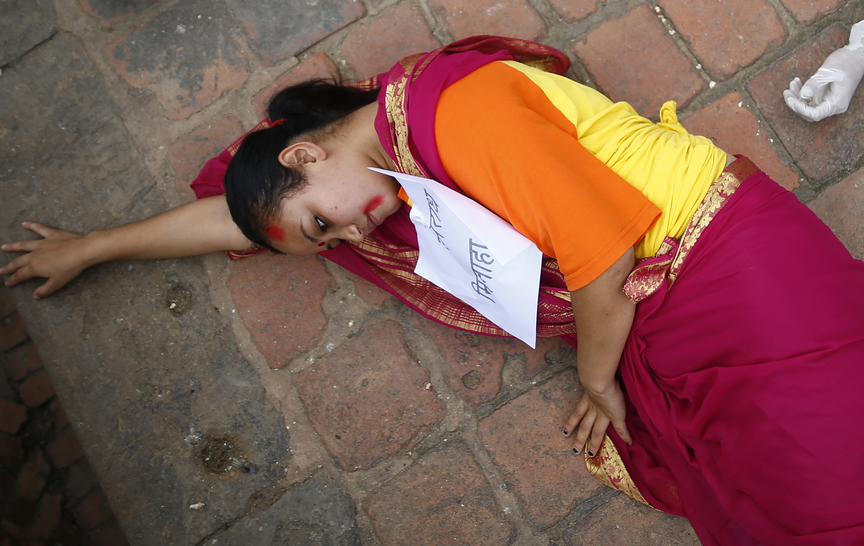 Artists stage a street drama to protest against the government, demanding better handling of the coronavirus crisis, justice for Nirmala Panta who was raped and murdered more than two years ago, severe punishment for acid attackers, among others, at Patan Durbar Square, in Lalitpur, on Saturday, August 8, 2020. Photo: Skanda Gautam/THT