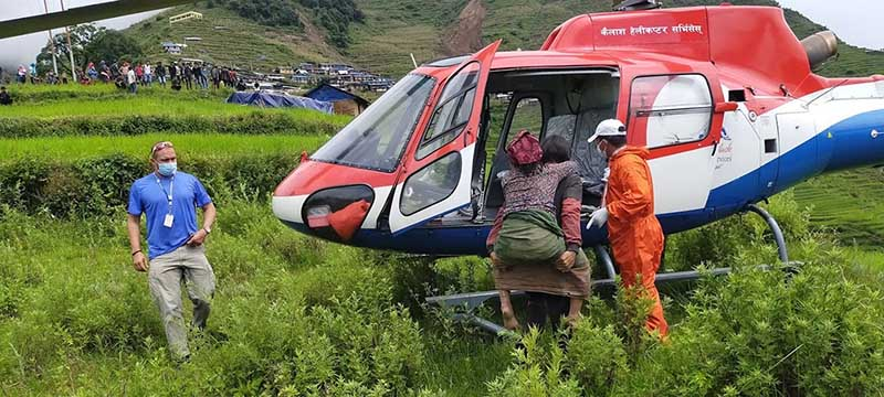 A landslide survivor being airlifted from Lidi in Jugal, Sindhupalchowk, to be taken to Kathmandu for treatment, on Friday, August 14, 2020. Photo: RSS