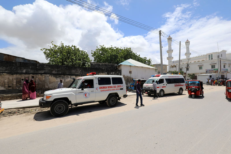 An ambulance is seen near a blast site that rocked a military base in Mogadishu, Somalia August 8, 2020. Photo: Reuters