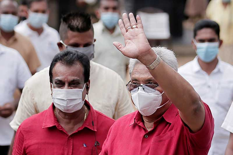 Sri Lanka's President Gotabaya Rajapaksa wears a protective mask as he waves to supporters while leaving a polling station, after casting his vote during the country's parliamentary election in Colombo, Sri Lanka, August 5, 2020. Photo: Reuters