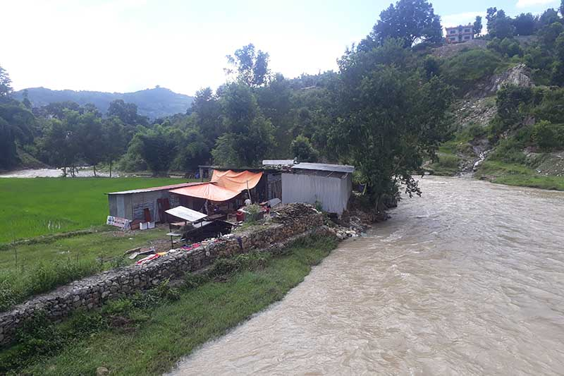 View of a human settlement on the bank of flooded Thopal River in Nilkantha Municipality, Dhading district, as seen on Monday, August 10, 2020. Photo: Keshav Adhikari/THT