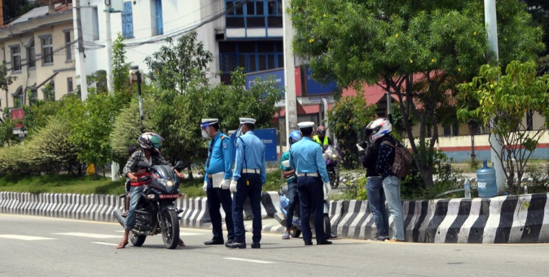 Traffic Police personnel carry out checking during the week-long prohibitory order to curb the spread of coronavirus infection, near Babar Mahal, Kathmandu, on Tuesday, August 25, 2020. Photo: Balkrishna Thapa/THT