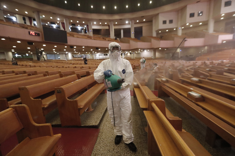 A public official disinfects as a precaution against the coronavirus at the Yoido Full Gospel Church in Seoul, South Korea, Friday, Aug. 21, 2020. Photo: AP