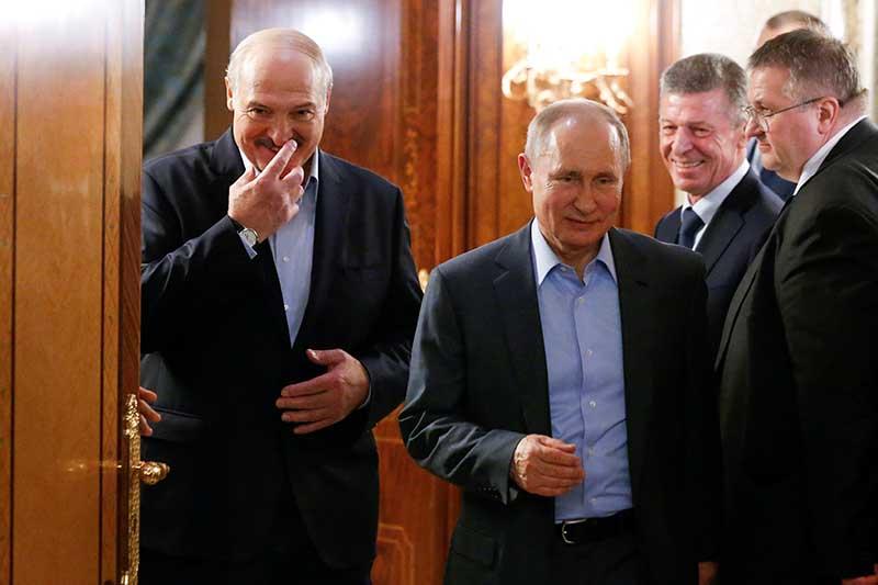 File - Russian President Vladimir Putin and Belarusian President Alexander Lukashenko walk during their meeting in the Black sea resort of Sochi, Russia, on February 7, 2020. Photo: Alexander Zemlianichenko/Pool via ReutersPhoto