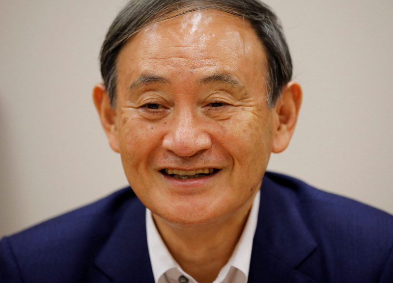 Japan's top government spokesman Chief Cabinet Secretary Yoshihide Suga smiles during an interview with Reuters in Tokyo, Japan August 26, 2020. Photo: Reuters/File