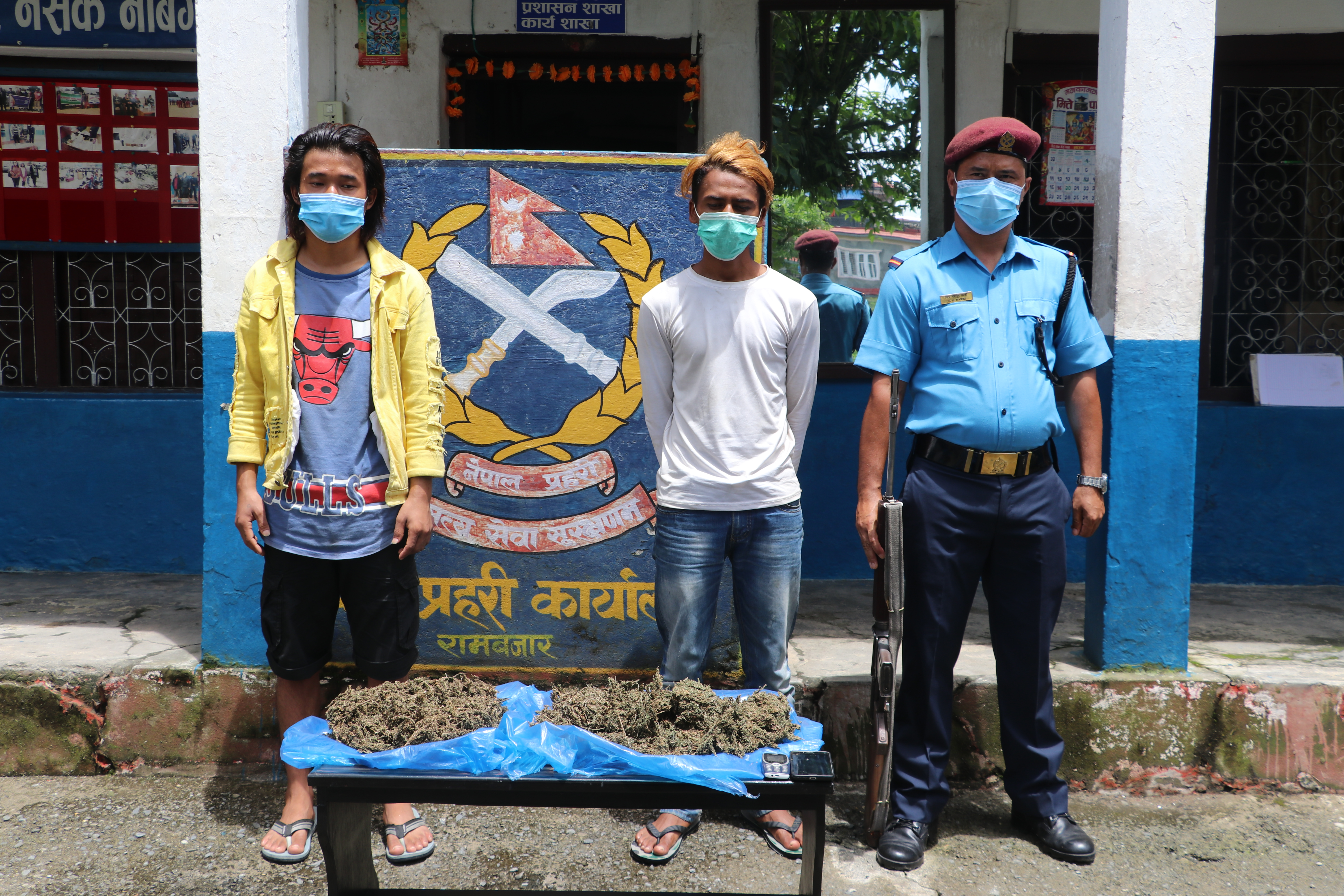 Police making two persons public along with seized illegal drugs at District Police Office, in Pokhara, on Monday, August 10, 2020. Photo: Rishi Ram Baral/THT