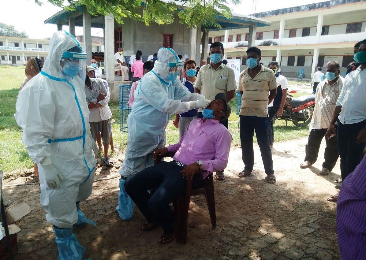 Health workers collecting the swabof Arun Kumar Sah, chair of Durgabhagawati Rural Municipality, for PCR test at Saraswati Secondary School, Rautahat, on Sunday. Photo: THT