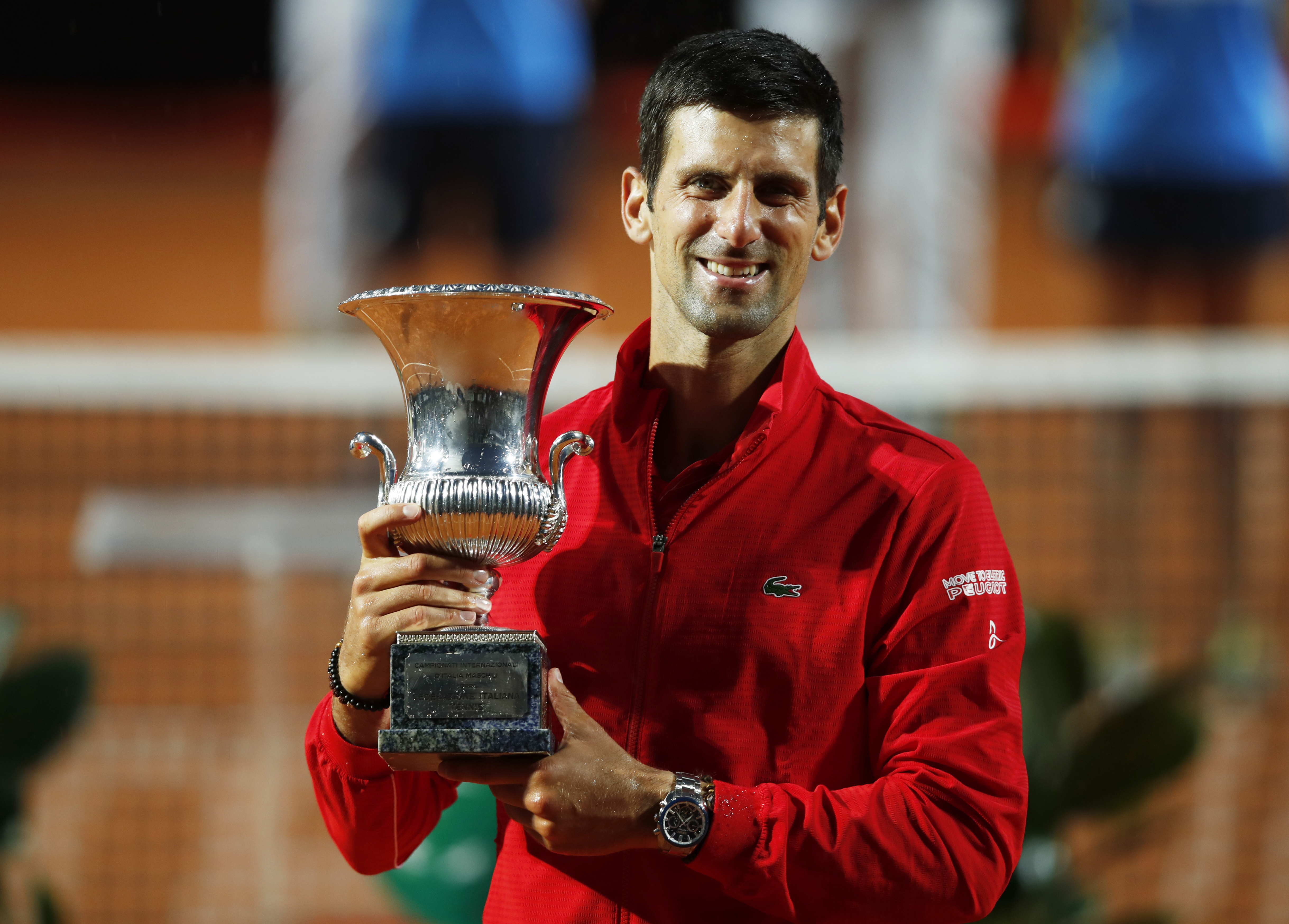 Serbia's Novak Djokovic celebrates with the trophy after winning the final against Argentina's Diego Schwartzman. Photo: Reuters