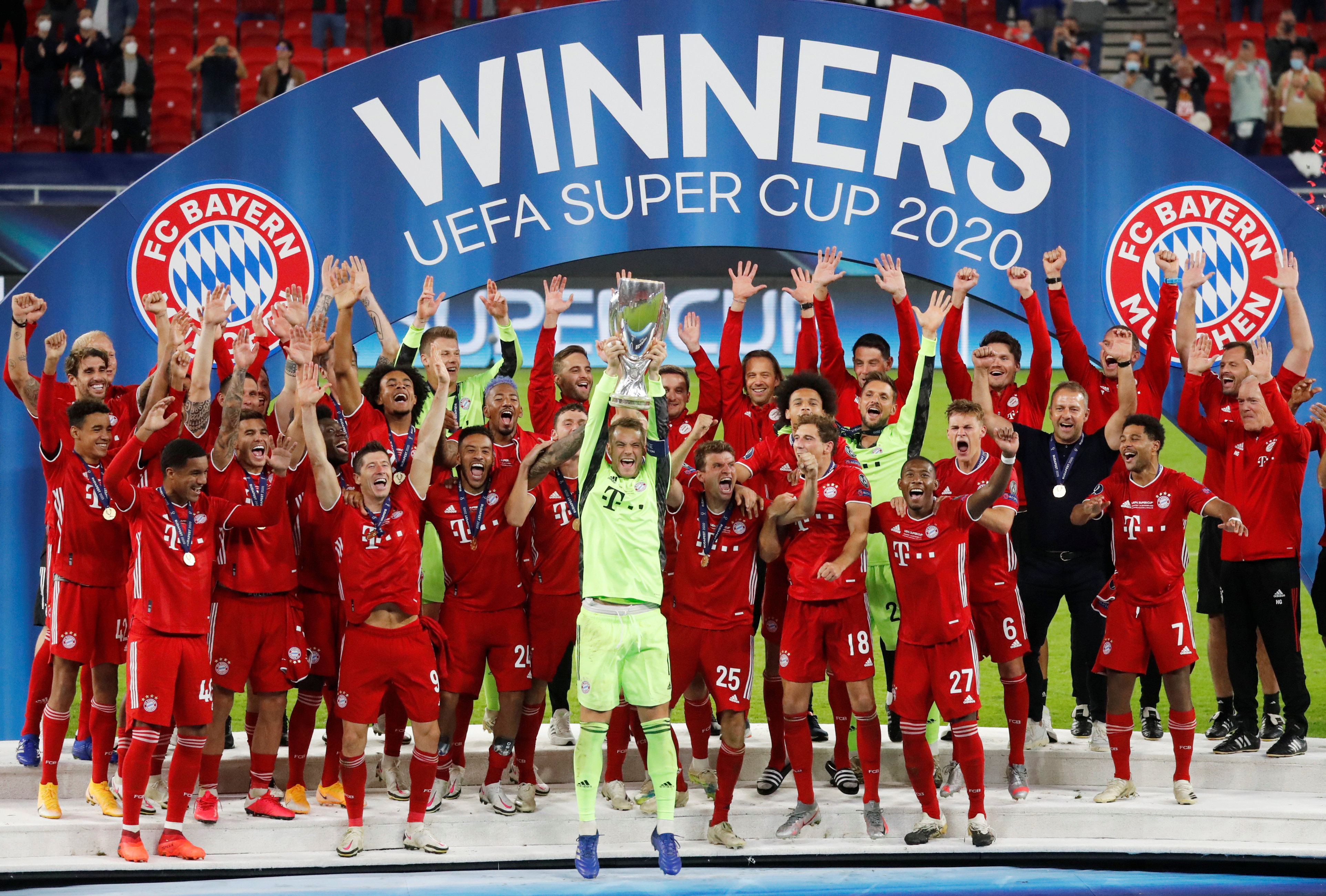 Bayern Munich's Manuel Neuer celebrates with the trophy and teammates after winning the European Super Cup. Photo: Reuters