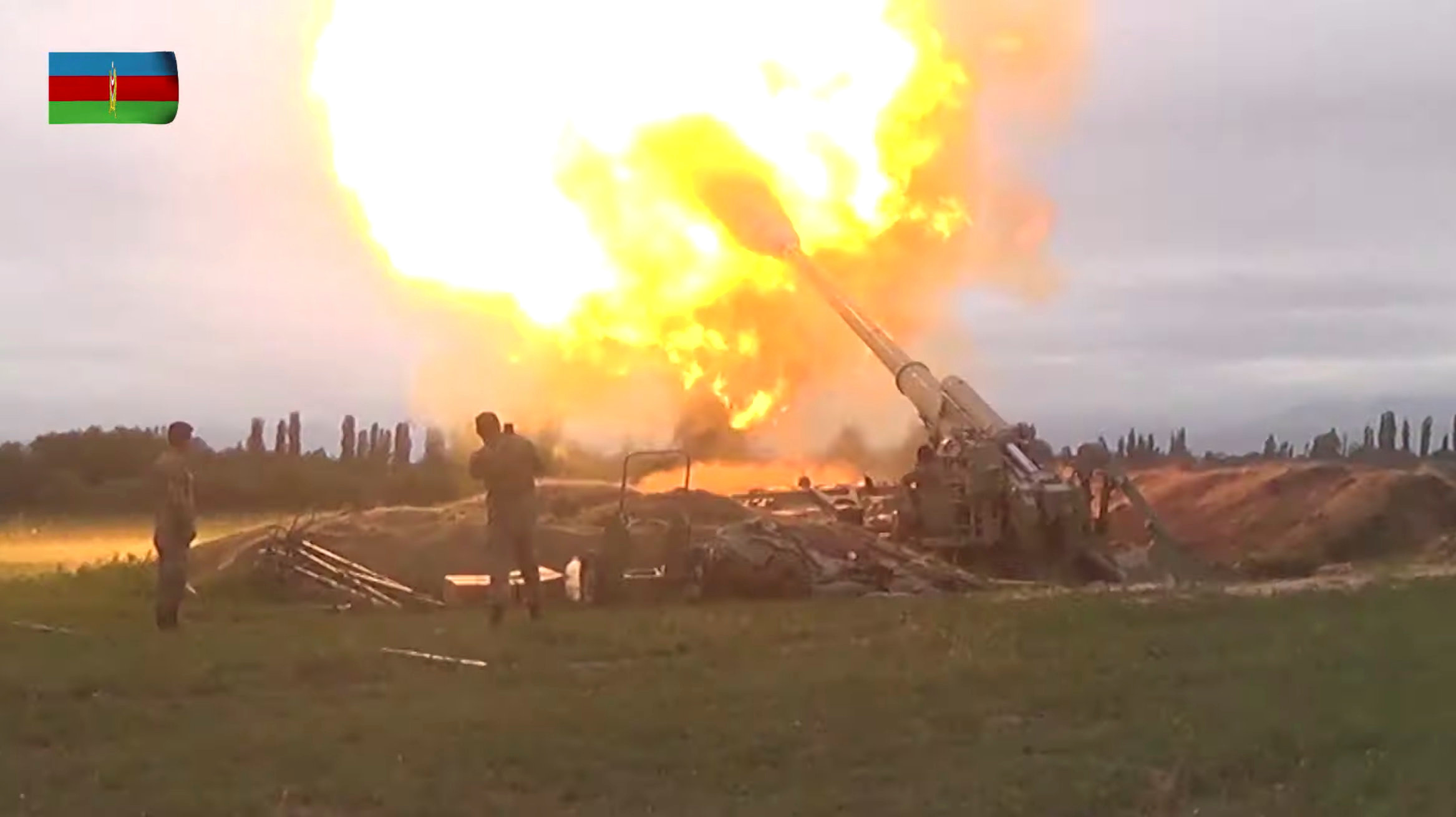 A still image from a video released by the Azerbaijan's Defence Ministry shows members of Azeri armed forces firing artillery during clashes between Armenia and Azerbaijan over the territory of Nagorno-Karabakh in an unidentified location, in this still image from footage released September 28, 2020. Defence Ministry of Azerbaijan