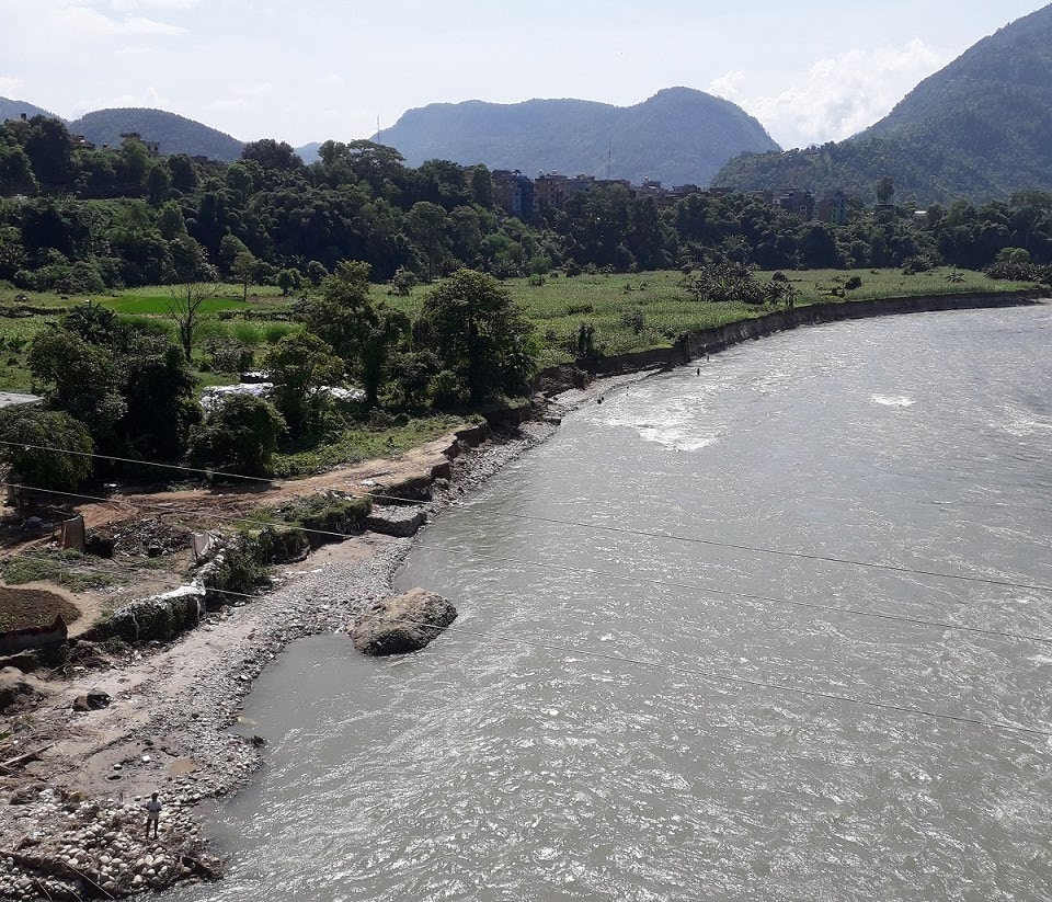 A view of the land strip eroded by the swollen Madi River in Bhateri, Tanahun, on Monday. Photo: THT