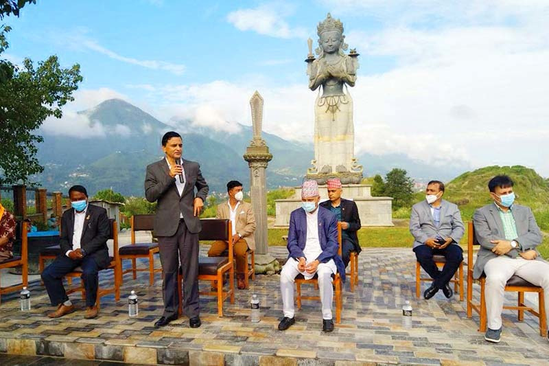 Tourism Minister Yogesh Bhattarai addressing an event organised to celebrate the 41st World Tourism Day, in Manjushree Park, Chobar, on Sunday. Photo courtesy: NTB