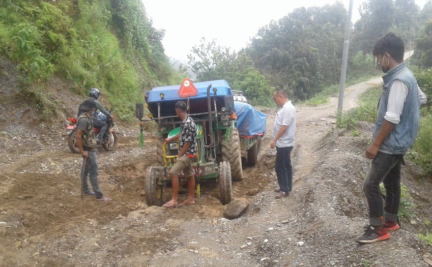 A tractor that got stuck along the Markuchhi-Bhutar road section at Puware, Udayapur, on Tuesday. Photo: THT